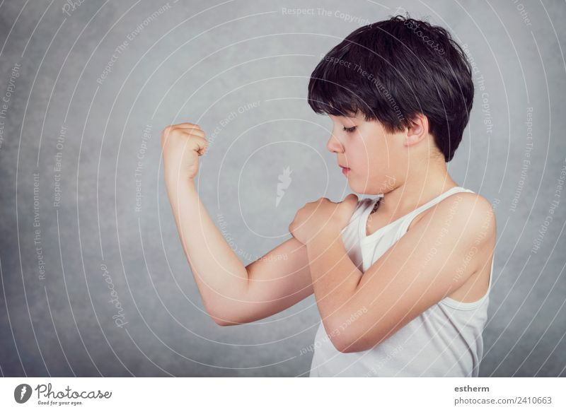 kid showing his muscles Lifestyle Wellness Sports Fitness Sports Training Success Human being Masculine Child Toddler Infancy 1 8 - 13 years Think Fight