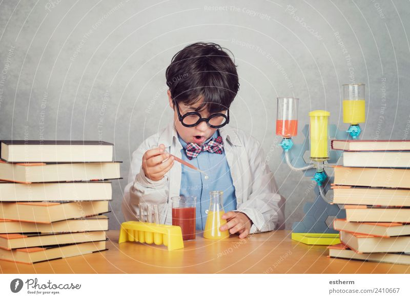 boy is making science experiments in a laboratory Lifestyle Education Science & Research School Study Student Laboratory Human being Masculine Child Toddler