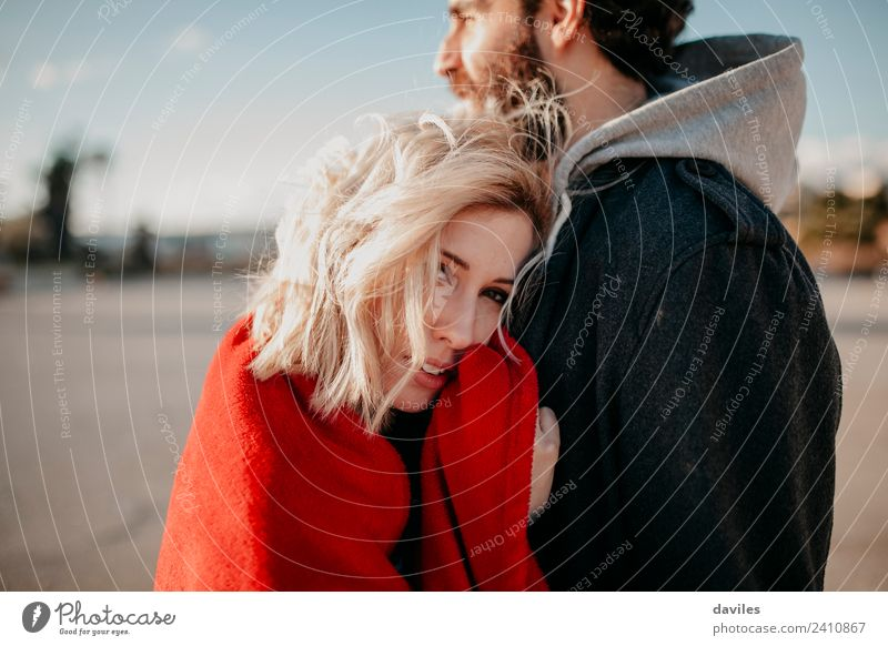 Blonde woman embracing her boyfriend Woman Man Sun Red Joy Winter Adults Lifestyle Love Couple Fashion Together Smiling Happiness Cool (slang)