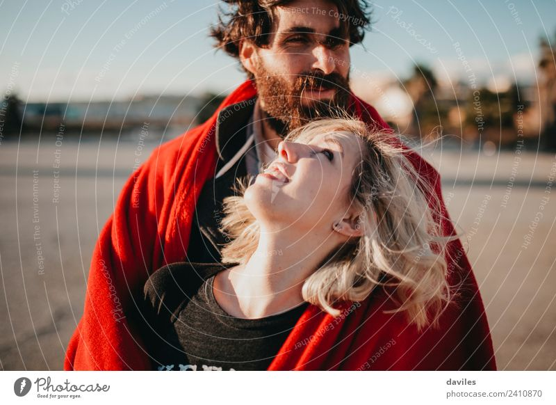 Happy blonde woman looking at her boyfriend. Woman Man Beautiful Sun Red Joy Adults Lifestyle Love Couple Fashion Blonde Smiling Happiness Relationship Lovers