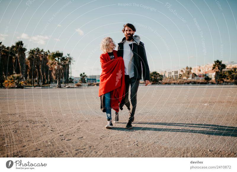 Cool alternative couple walking together outdoors. Woman Man Sun Red Joy Winter Adults Lifestyle Love Couple Modern Blonde Smiling Happiness Cool (slang)