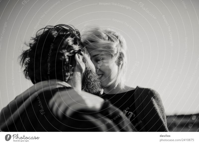 Black and white portrait of couple kissing outdoors. Joy Sun Human being Woman Adults Man Family & Relations Couple Partner 2 18 - 30 years Youth (Young adults)