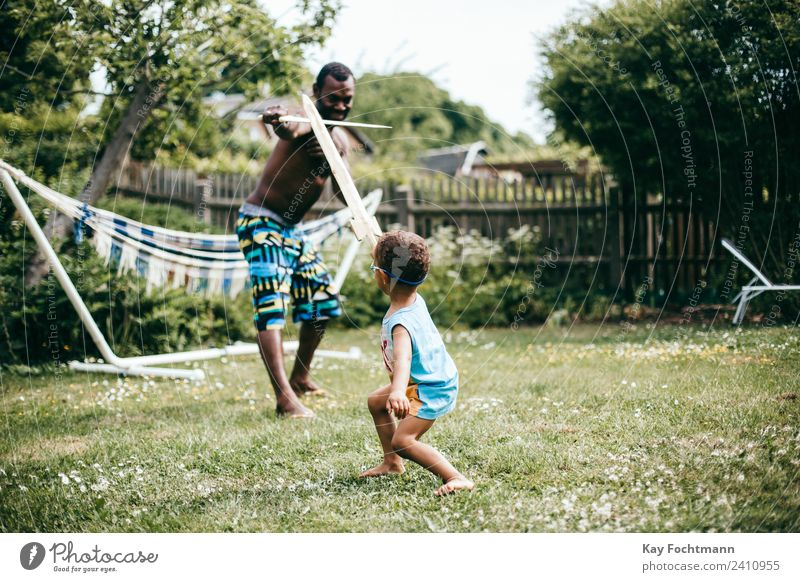 Father plays knight with his son in the garden Lifestyle Joy Well-being Contentment Vacation & Travel Freedom Summer Summer vacation Living or residing Garden