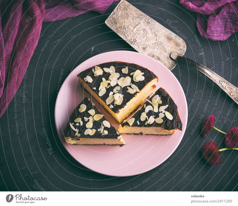 pieces of cheesecake with chocolate Cheese Dairy Products Dessert Candy Nutrition Restaurant Flower Fresh Delicious Above Black White Almond background Baking