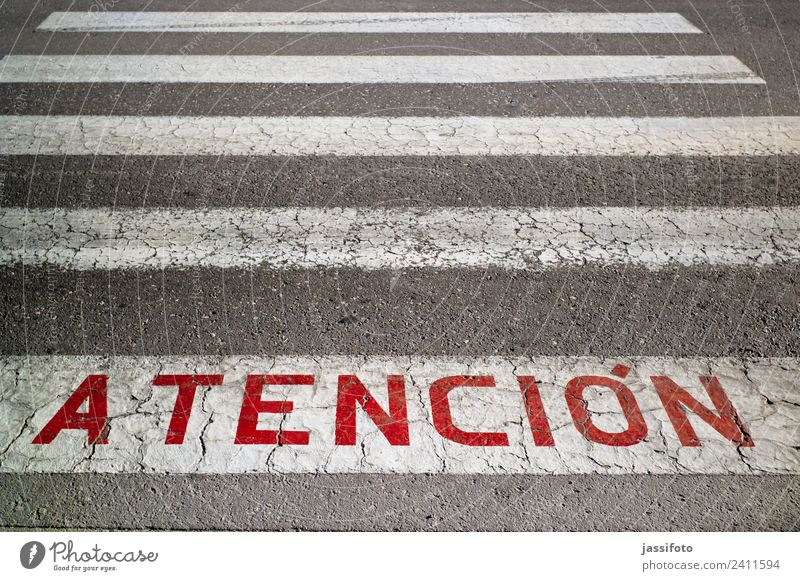 atención Road traffic Street Sign Characters Signs and labeling Stripe Red Asphalt attencion Lettering Traffic lane Lane markings Pedestrian crossing writing