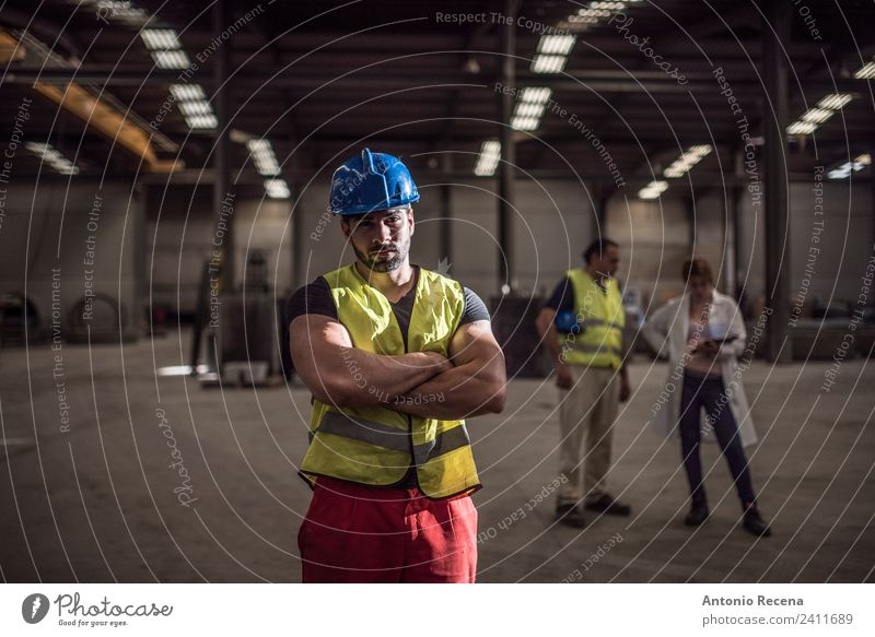Serious worker posing in factory Work and employment Profession Workplace Construction site Factory Industry Company Young man Youth (Young adults) Woman Adults