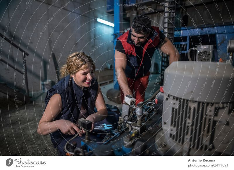 Couple working in factory with engine School Work and employment Factory Human being Woman Adults Man Underground Blonde Concrete Smiling Together Pregnant