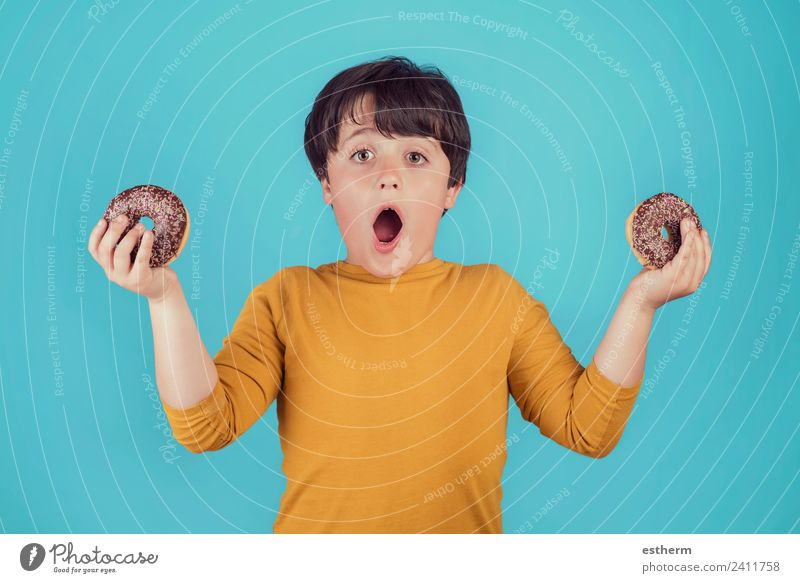 surprised boy with donuts in hands Child Human being Joy Eating Lifestyle Emotions Boy (child) Food Masculine Nutrition Infancy Smiling To enjoy Fitness
