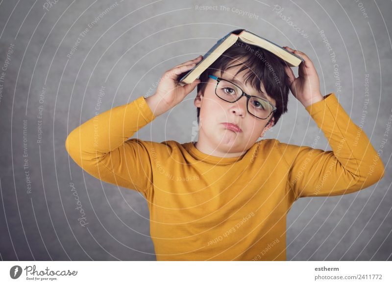 sad and pensive boy with a book Child Human being Lifestyle Sadness Emotions Boy (child) School Think Masculine Infancy Gloomy Study Fitness Paper Curiosity