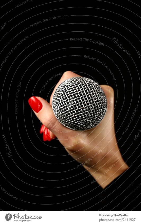 Woman hand holding microphone on black background Human being Young woman Youth (Young adults) Adults Hand 1 Music Concert Stage Singer Musician Record Media