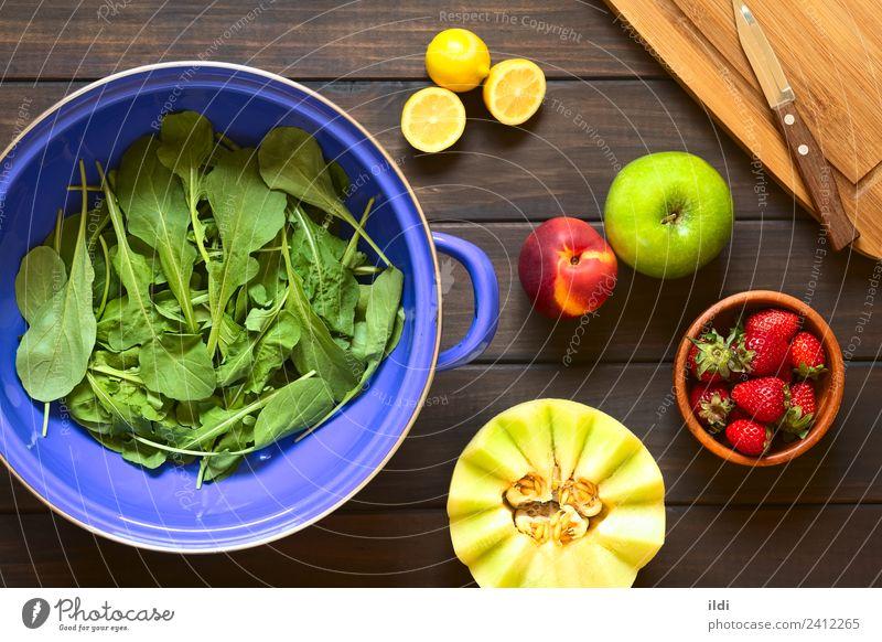 Rucola and Fruits Vegetable Fresh Salad Rocket lettuce rucoli rugula colewort eruca sativa food Ingredients healthy cooking strainer Lemon citrus Strawberry