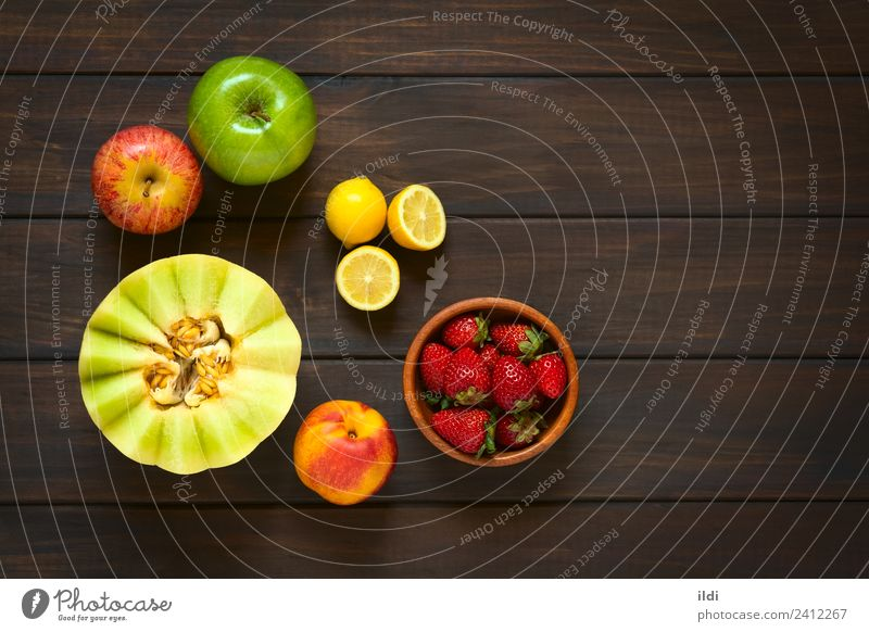 Variety of Fresh Fruits Apple Healthy Raw food Ingredients Snack Melon Honeydew Lemon citrus Plum Nectarine Strawberry Berries colorful Vitamin overhead Salad
