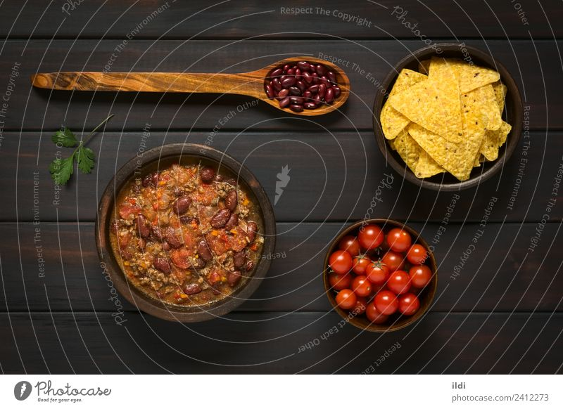 Chili con Carne and Tortilla Chips Meat Vegetable Fresh chili carne food Meal Dish Beef Ground minced mincemeat Beans Pulse legume Tomato stew Home-made Rustic