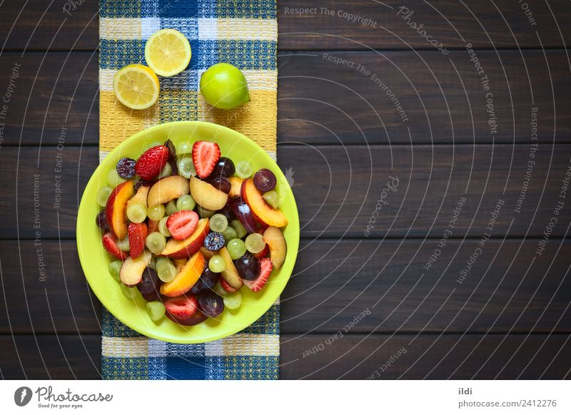 Fresh Fruit Salad Healthy Raw Plum Nectarine Strawberry colorful food Snack Vitamin Lemon overhead Horizontal grape copy space fruit salad sweet dessert