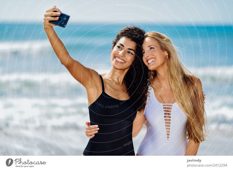 Two girls taking selfie photograph with smart phone Lifestyle Joy Happy Beautiful Body Leisure and hobbies Vacation & Travel Tourism Summer Beach Human being