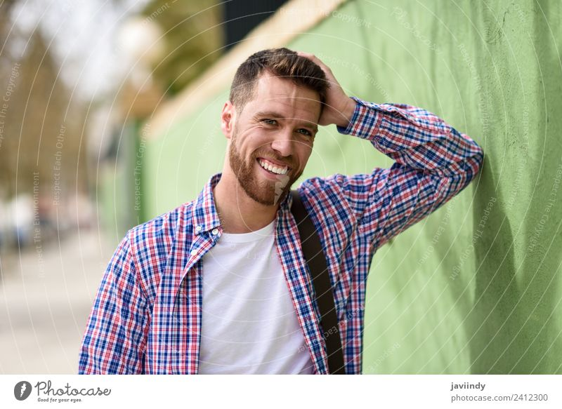 Attractive young man laughing outdoors. Lifestyle Style Happy Vacation & Travel Human being Masculine Young man Youth (Young adults) Man Adults 1 18 - 30 years