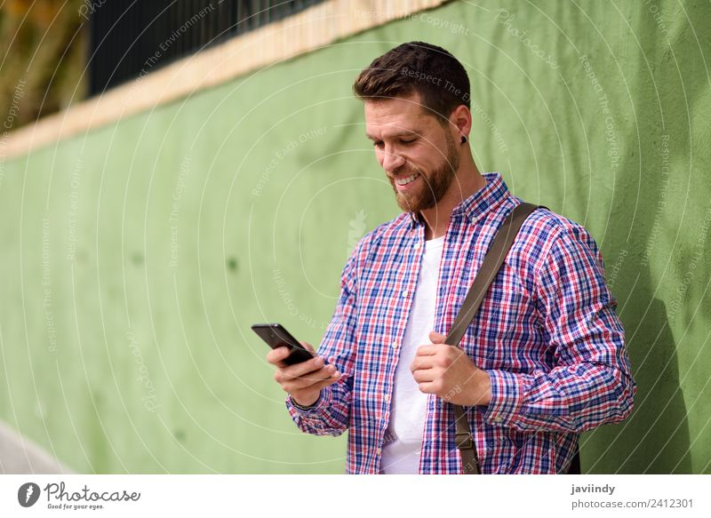Young man looking at his smart phone Lifestyle Style Happy Vacation & Travel Telephone PDA Technology Human being Youth (Young adults) Man Adults 1
