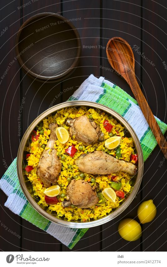 Spanish Chicken Paella Meat Vegetable Fresh paella poultry Thigh Rice Dish Meal food Valencian Mediterranean cooking Pepper Peas legume Pulse Lemon citrus