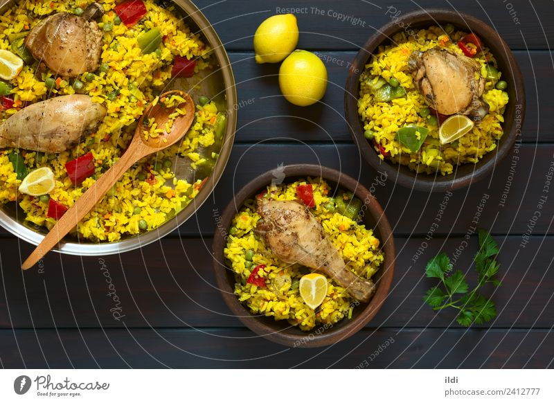 Spanish Chicken Paella Meat Vegetable Fresh paella poultry Thigh Rice Dish Meal food Valencian Mediterranean cooking pepper Peas legume Pulse Lemon Rustic
