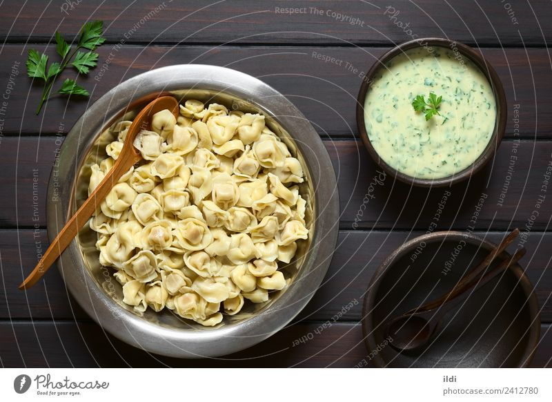 Cooked Tortellini Dough Baked goods Fresh food pasta Dumpling filled Parsley cream Sauce Dip Home-made Italian cooking Meal Dish belly Buttons Navel shaped