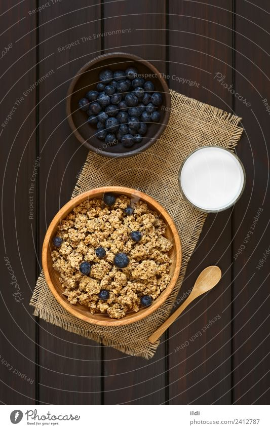 Breakfast Cereal with Blueberries and Milk Fruit Fresh food oatmeal Rolled Berries Blueberry dry sweet sweetened healthy Meal Snack milk glass Rustic Dairy
