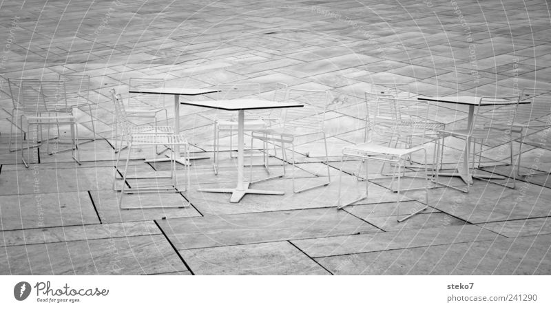 Chairs back II Stone Cold Gray White Norway Oslo Table Terrace Black & white photo Exterior shot Deserted