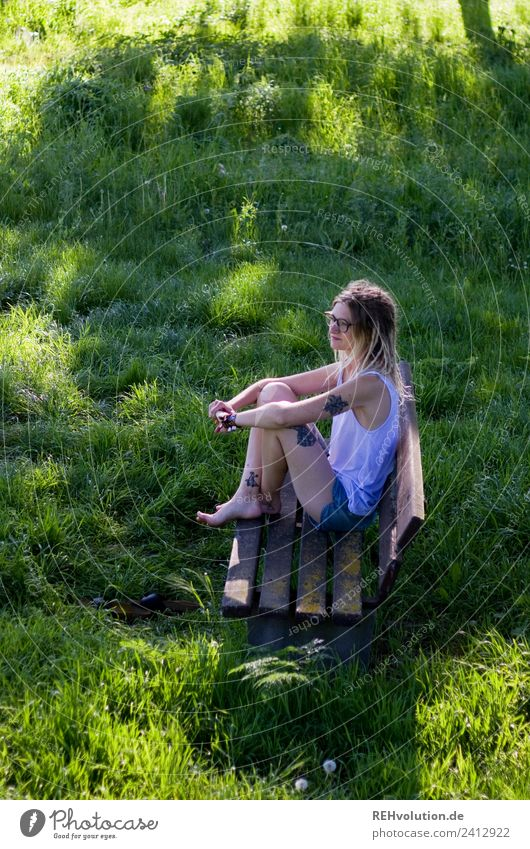 Jule Young woman with dreads is sitting on a bench in the green. Lifestyle Style Leisure and hobbies Bench Human being Feminine Youth (Young adults) 1