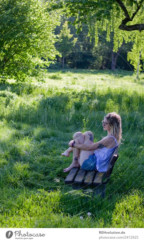 Jule Young woman with dreads is sitting on a bench in the green. Lifestyle Style Happy Harmonious Well-being Contentment Relaxation Calm Leisure and hobbies