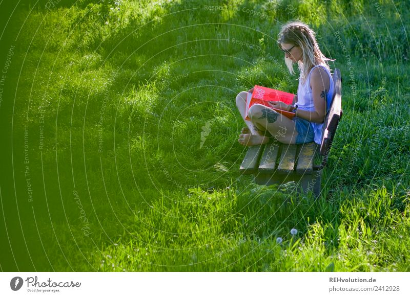 Jule Young woman with dreads reading on a bench in the country Well-being Contentment Relaxation Calm Study University & College student Human being Feminine