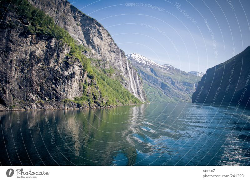 Blue Vacation & Travel Green Mountain Coast Waves Beautiful weather Cloudless sky Fjord Water Waterway Geirangerfjord