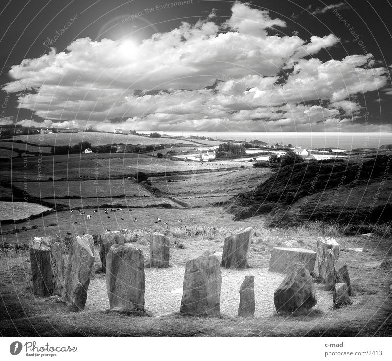 Sun Ocean Clouds Meadow Grass Moody Field Manmade structures Black & white photo Stone Ireland Sculpture Plant Peoples Celts Stone block