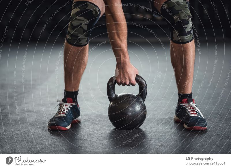 0f72e72429ee6 Man Kettle bell workout - a Royalty Free Stock Photo from Photocase