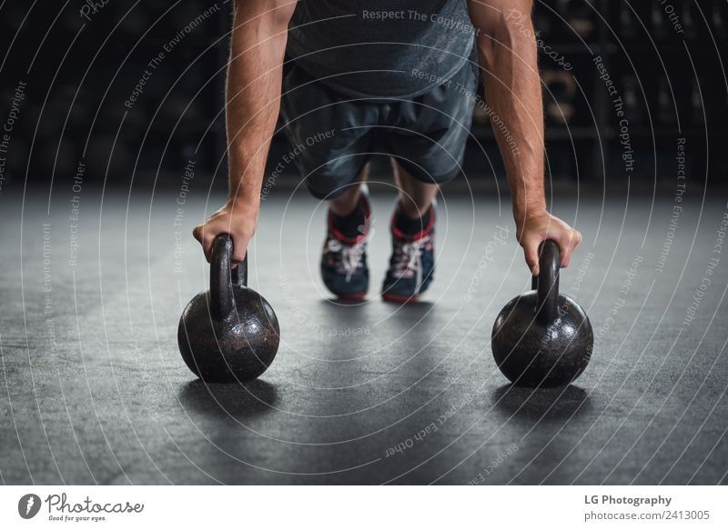 0836f1ee88a20 Kettle bell push up - a Royalty Free Stock Photo from Photocase