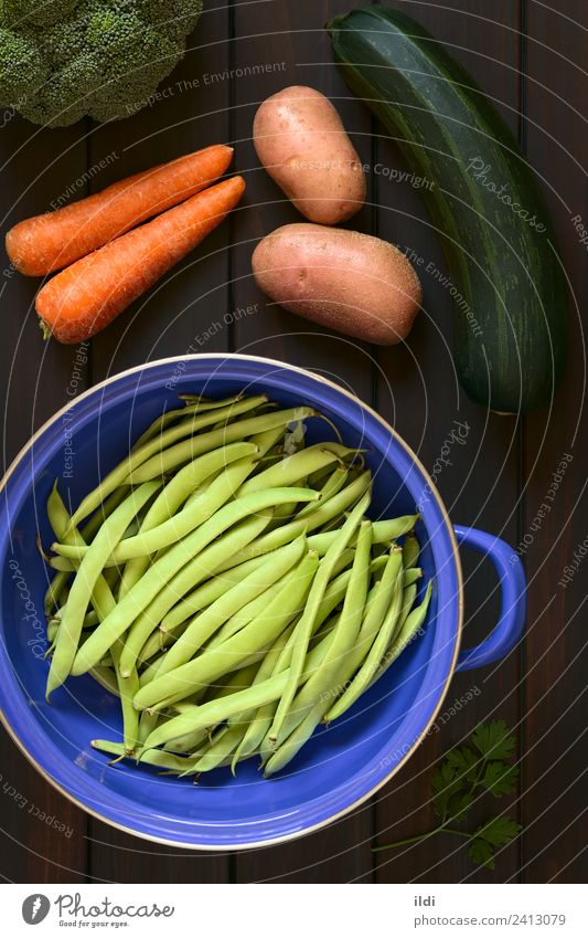 Raw Green Beans and Other Vegetables Nutrition Vegetarian diet Fresh Healthy food cooking Broccoli Carrot Zucchini courgette Parsley strainer legume Pulse