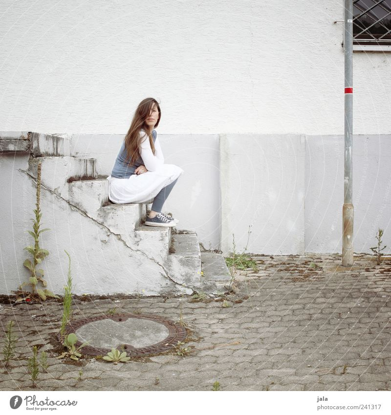 Woman Human being Plant House (Residential Structure) Adults Feminine Window Wall (building) Building Wall (barrier) Facade Sit Wait Stairs Manmade structures