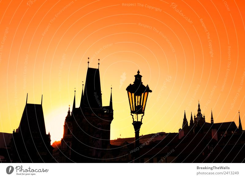 Sunset backlit silhouettes of roofs at Charles Bridge in Prague Vacation & Travel Tourism Sightseeing City trip Cloudless sky Town Old town Skyline Church Dome