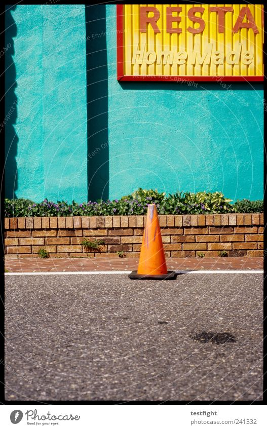 skittles Small Town Wall (barrier) Wall (building) Facade Street Illuminate Exotic Restaurant Traffic cone Wall plant Colour photo Exterior shot Deserted Light