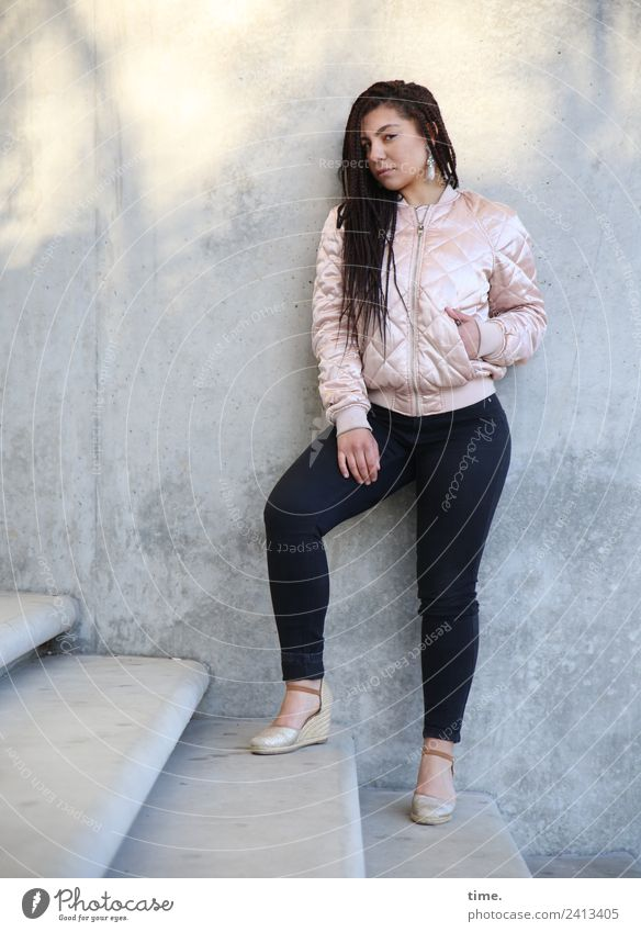 Nikoliya Feminine Woman Adults 1 Human being Wall (barrier) Wall (building) Stairs Pants Jacket Earring Brunette Long-haired Observe Looking Stand Cool (slang)