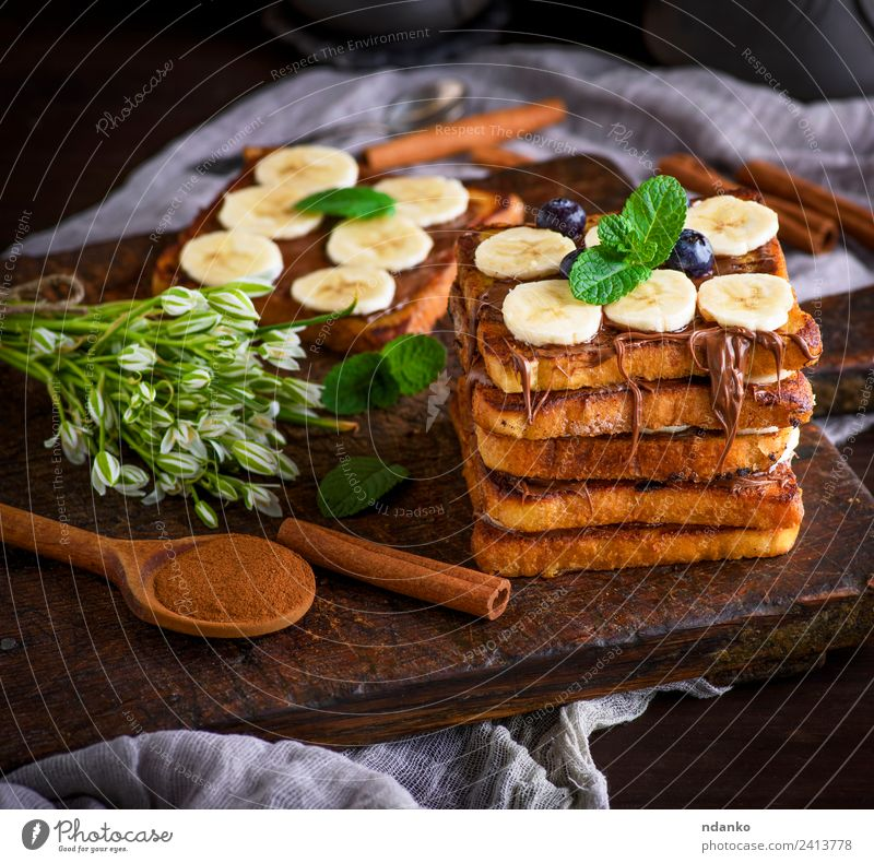French toast for breakfast Fruit Bread Dessert Nutrition Breakfast Spoon Flower Wood Fresh Delicious Above Tradition french Banana chocolate background food