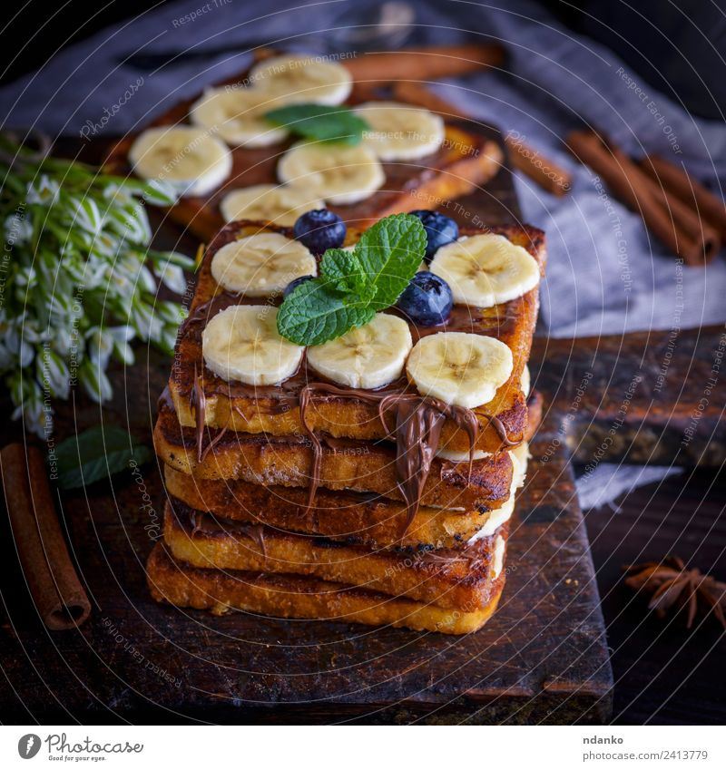 bread slices with chocolate Fruit Bread Dessert Candy Nutrition Breakfast Flower Wood Eating Fresh Delicious Above Tradition toast french Banana background food