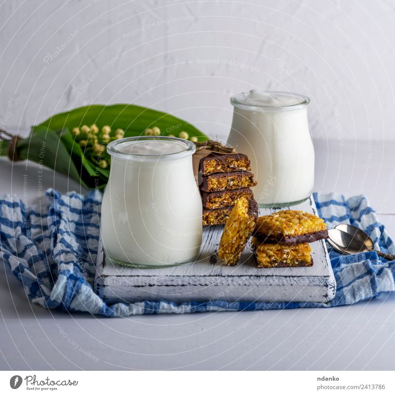 homemade yogurt in a glass jar Yoghurt Dairy Products Nutrition Breakfast Diet Glass Spoon Table Wood Fresh Blue White Health care Greek Snack food healthy