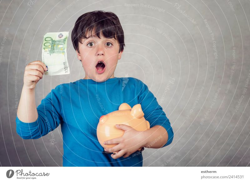 surprised child saving money in a piggy bank Lifestyle Shopping Luxury Joy Happy Money Economy Financial Industry Financial institution Success Human being