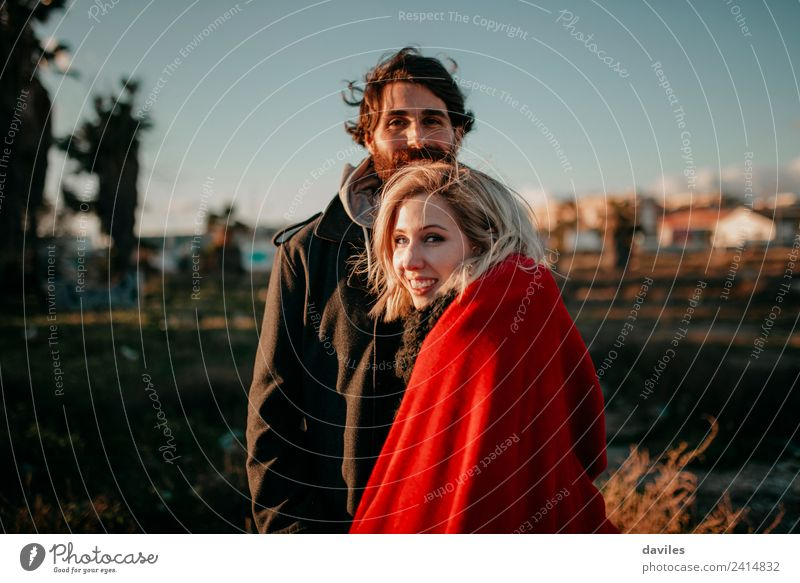 Smiling couple enjoying a journey together Lifestyle Joy Playing Human being Young man Youth (Young adults) Couple 1 18 - 30 years Adults Wind Deserted Blonde