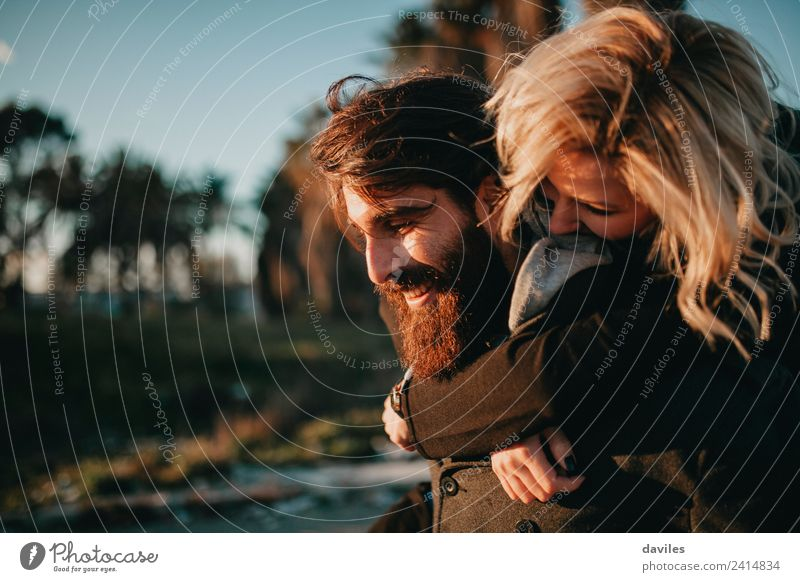 Cool hipster couple embraced and having fun while smiling happy outdoors. Lifestyle Joy Playing Woman Adults Man Couple 2 Human being Blonde Beard Smiling