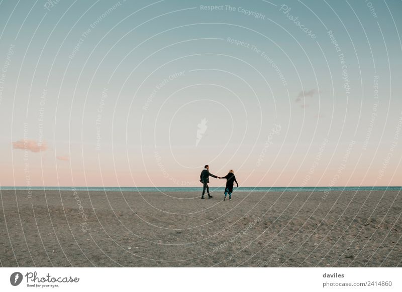 Couple walking by the hand in the beach Woman Human being Nature Youth (Young adults) Man Young woman Young man Ocean Winter Beach Adults Lifestyle Love