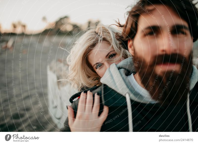 Blonde woman embracing her boyfriend Woman Human being Youth (Young adults) Man Young woman Young man 18 - 30 years Adults Lifestyle Environment Love Emotions