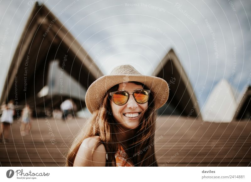 Lovely woman with hat and sunglasses looking at camera, while visiting Sydney Opera House, Australia. Lifestyle Joy Vacation & Travel Tourism City trip Summer