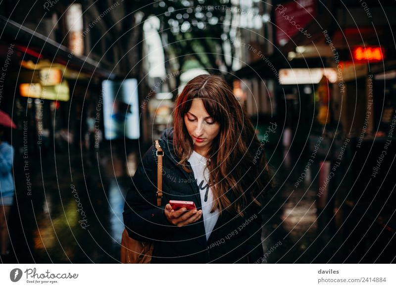 Young woman looking for restaurant in her mobile phone in Sydney city. Shopping Vacation & Travel Tourism Restaurant Business Telephone Cellphone Technology