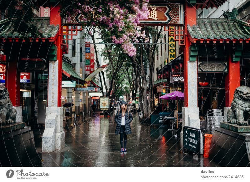 Young woman standing under Chinatown neighbourhood arch in Sydney city, Australia. Shopping Vacation & Travel Tourism Business Feminine Youth (Young adults)
