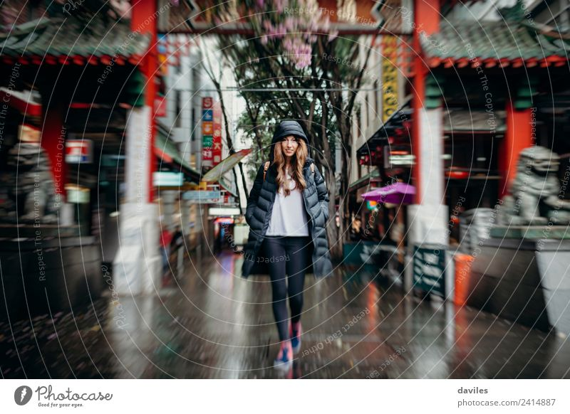 Young white woman walking across Chinatown neighbourhood in Sydney city, Australia. Shopping Vacation & Travel Tourism Business Human being Young woman